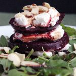 Beets with goat cheese, arugula and almonds