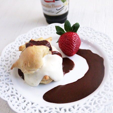Profiterole with berries and chocolate sauce