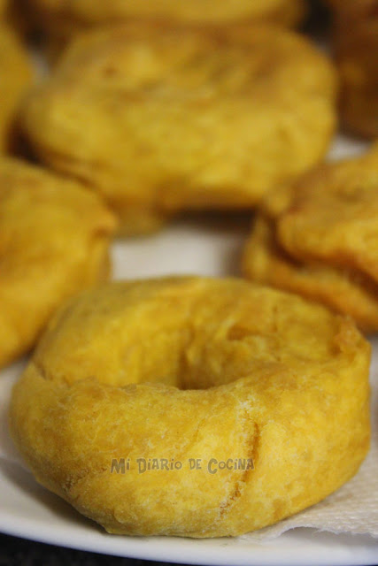 Picarones (pumpkin donuts) with panela sauce